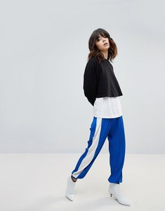 Read more about Asos plisse joggers with side stripe - blue white
