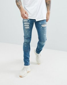 Read more about Asos super skinny jeans in smokey blue with rip and repair - dark wash blue