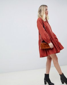 Read more about Asos design tiered trapeze mini dress in broderie