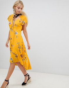 Read more about Free people lost in you floral dip hem wrap dress - yellow combo
