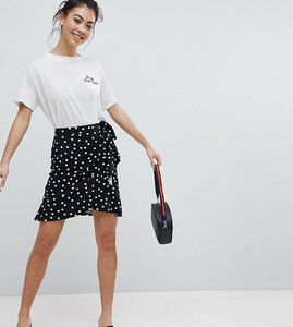 Read more about Asos petite mini wrap skirt in polka dot print - black white