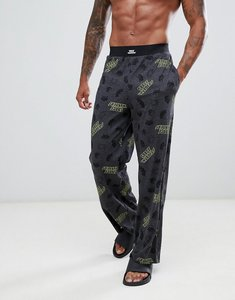 Read more about Asos design straight pyjama bottoms in space invaders print - grey