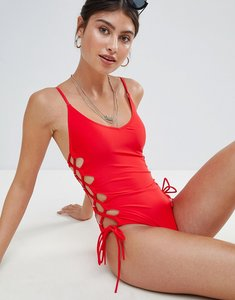 Read more about Missguided high leg lace up swimsuit - red