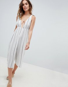 Read more about Asos design irregular stripe plunge culotte beach jumpsuit - stripe