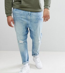 Read more about Asos design plus drop crotch jeans in mid wash blue with rips - mid wash blue