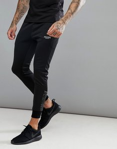 Read more about Muscle monkey skinny track joggers in black with reflective speckle - black