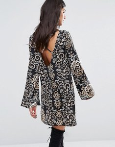 Read more about Missguided cross back printed swing dress - multi