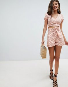 Read more about Missguided polka dot tie waist shorts - peach