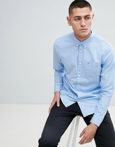Read more about Hollister poplin icon seagull logo button down collar stretch slim fit pocket shirt in light blue -