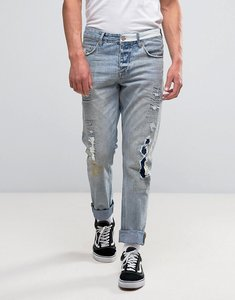 Read more about Asos slim jeans with rip and repair details in vintage light wash - light blue