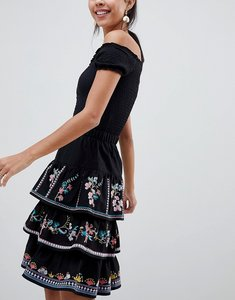 Read more about Asos design tiered mini sun skirt with embroidery - black