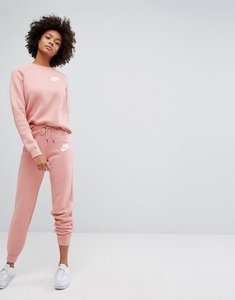 Read more about Nike rally tight fit sweat pants - red stardust