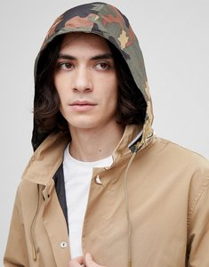 Read more about Herschel supply co stowaway mac with concealed camo print hood in beige - woodland camo