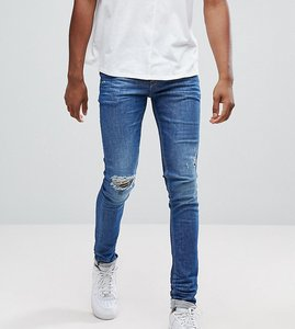 Read more about Asos tall super skinny jeans in mid wash blue with rip and repair - mid wash blue
