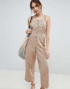 Read more about Asos jumpsuit with elasticated waist and button detail in twill - stone