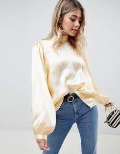 Read more about Asos design satin blouse with high neck and open back - buttermilk