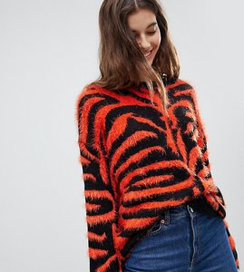 Read more about E l k high neck jumper in tiger print fluffy knit - orange and black