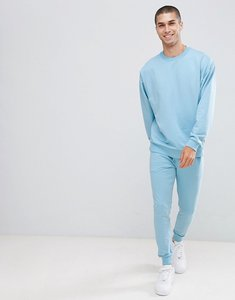 Read more about Asos design tracksuit oversized sweatshirt super skinny joggers in sky blue - sky blue