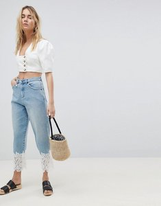 Read more about Asos design boyfriend jeans in mid wash with lace hem - mid wash blue