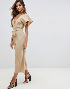 Read more about Asos design tea jumpsuit with button front and tie detail - dark beige