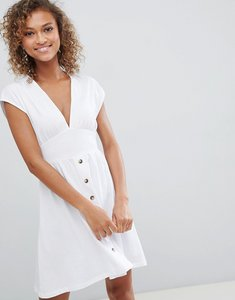 Read more about Asos design mini dress with belt and faux tortoiseshell buttons - white