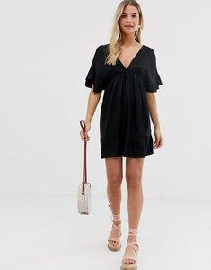 Read more about Asos design v front v back smock mini dress with pep hem