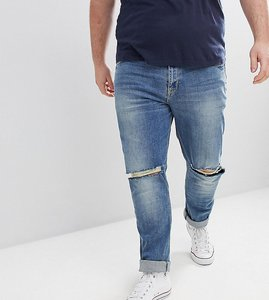 Read more about Asos design plus skinny jeans in mid wash with knee rips - mid wash blue