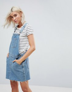 Read more about Asos design denim dungaree dress in midwash blue - blue