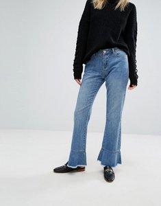 Read more about Vero moda ruffle hem jeans - light blue denim