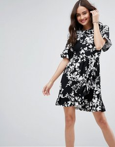 Read more about Asos mini tea dress with frill wrap in mono print - mono floral