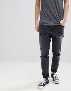 Read more about Asos tapered jeans in washed black with faux leather rip repair - washed black