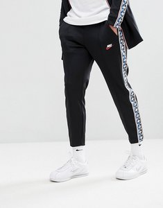 Read more about Nike joggers with taped side stripe in regular fit in black aj2297-010 - black