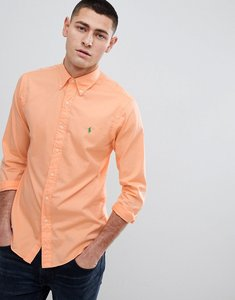 Read more about Polo ralph lauren slim fit garment dyed shirt polo player in orange - classic peach