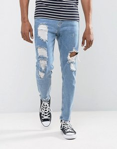Read more about Asos tapered jeans in vintage light wash blue with heavy rips - light wash vintage