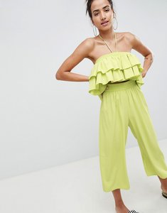 Read more about Asos design ruffle bandeau jumpsuit with cut out waist detail - green