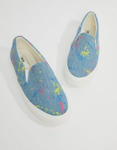Read more about Asos design slip on plimsolls in washed denim with splatter print - grey