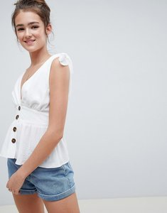 Read more about Asos design button front sun top with tie shoulder detail in white - white