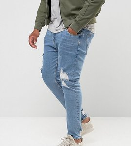 Read more about Asos design plus skinny jeans in light wash blue vintage with heavy rips and repair - light wash vin