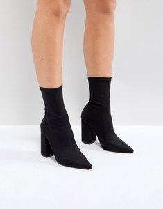 Read more about Asos ebonie high heeled sock boots - black