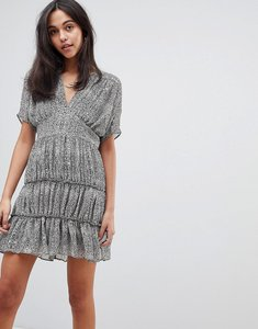 Read more about Asos design soft mini dress with tiers in animal print - multi