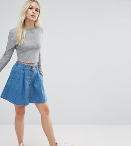 Read more about Asos petite denim button front mini skater skirt in mid wash blue - blue