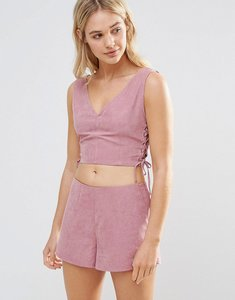 Read more about Neon rose pink faux suede lace up crop top - pink