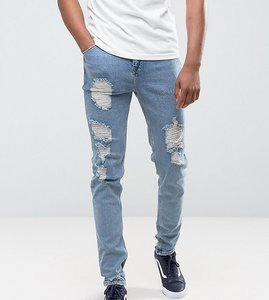 Read more about Asos tall tapered jeans in vintage light wash blue with heavy rips - light wash vintage
