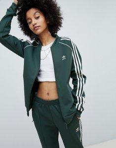 Read more about Adidas originals adicolor three stripe track jacket in green - green