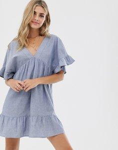 Read more about Asos design v front v back smock mini dress in chambray