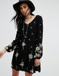 Read more about Free people embroidered mini smock dress - black combo