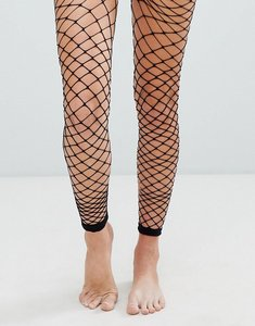 Read more about Asos oversized footless fishnet tights - black