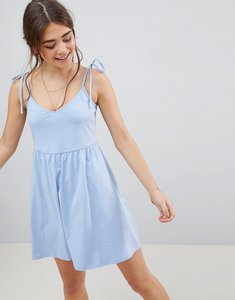 Read more about Asos design mini smock sundress with tie straps - chambray