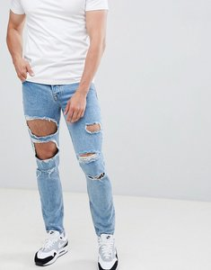 Read more about Asos design slim jeans in mid wash blue with heavy rips - mid wash vintage