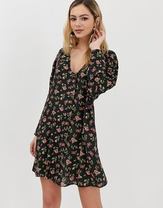 Read more about Asos design button through trapeze mini dress with long sleeves in ditsy floral - multi